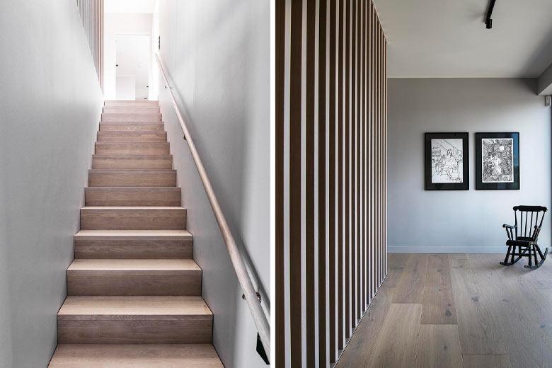 Spaljéväggen i den raka trappan blir som ett konstverk hemma hos familjen Crozzoli i Lerum.